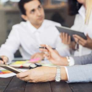 business-people-at-business-meeting-in-office-3VDS54N